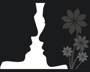 Lovers face to face silhouettes